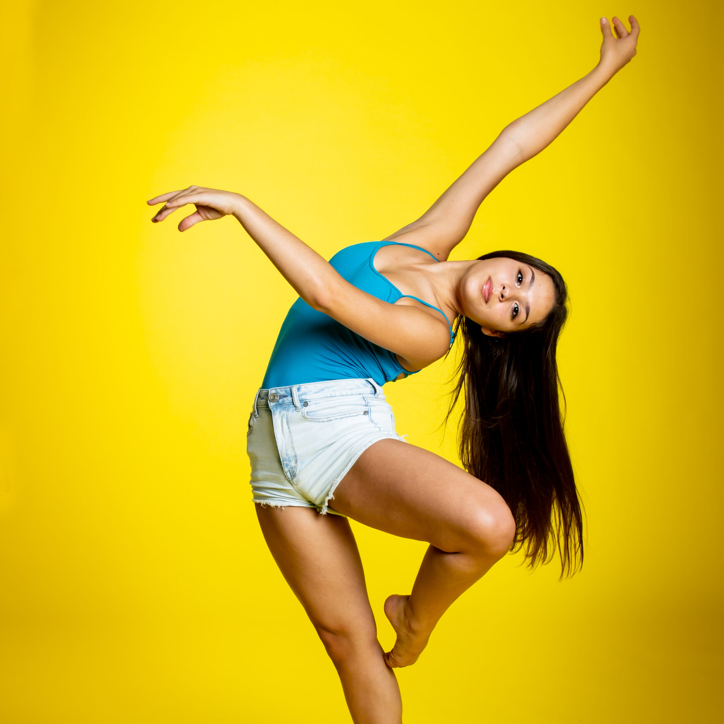Young Female Dancer Yellow Background