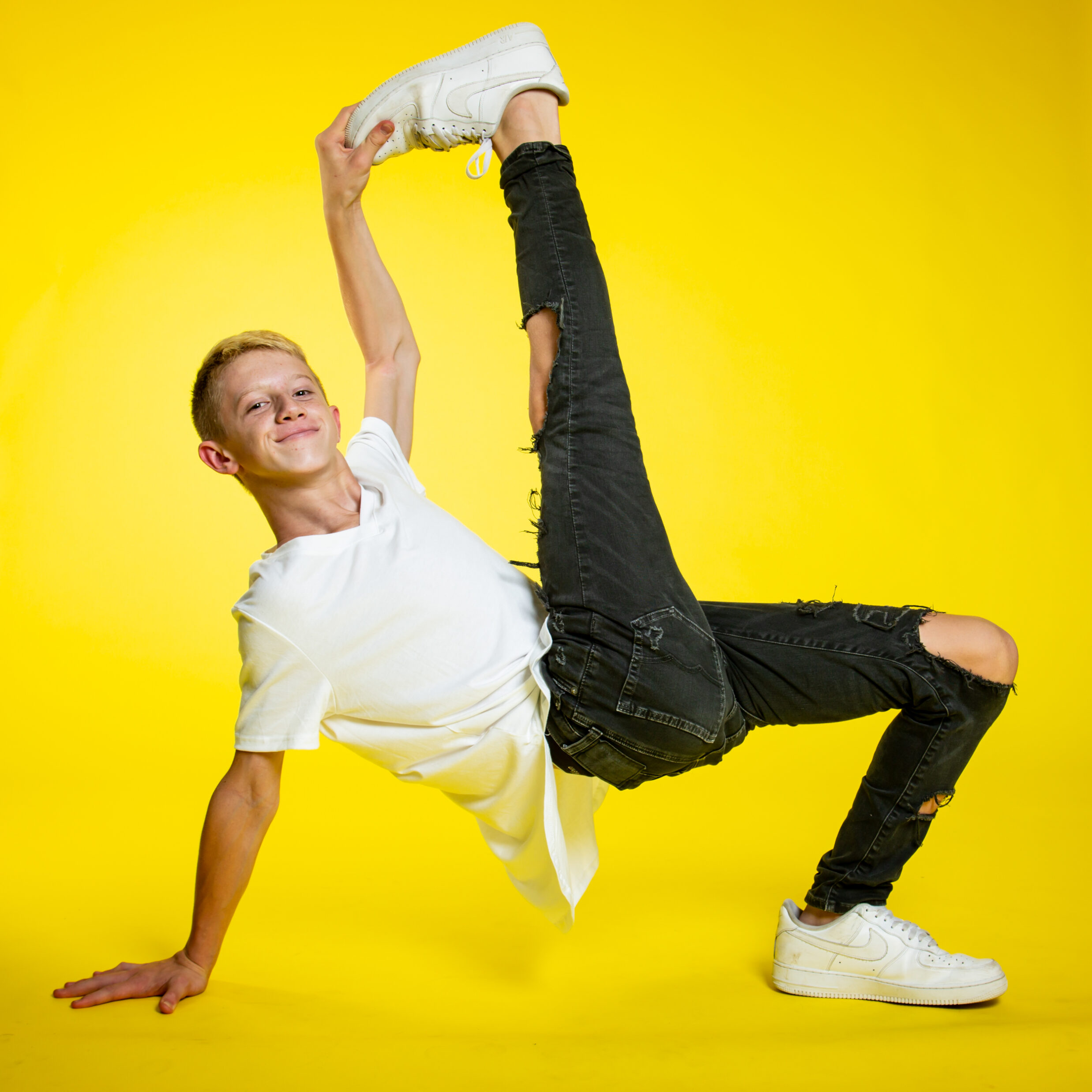 Young Male Dancer Yellow Background