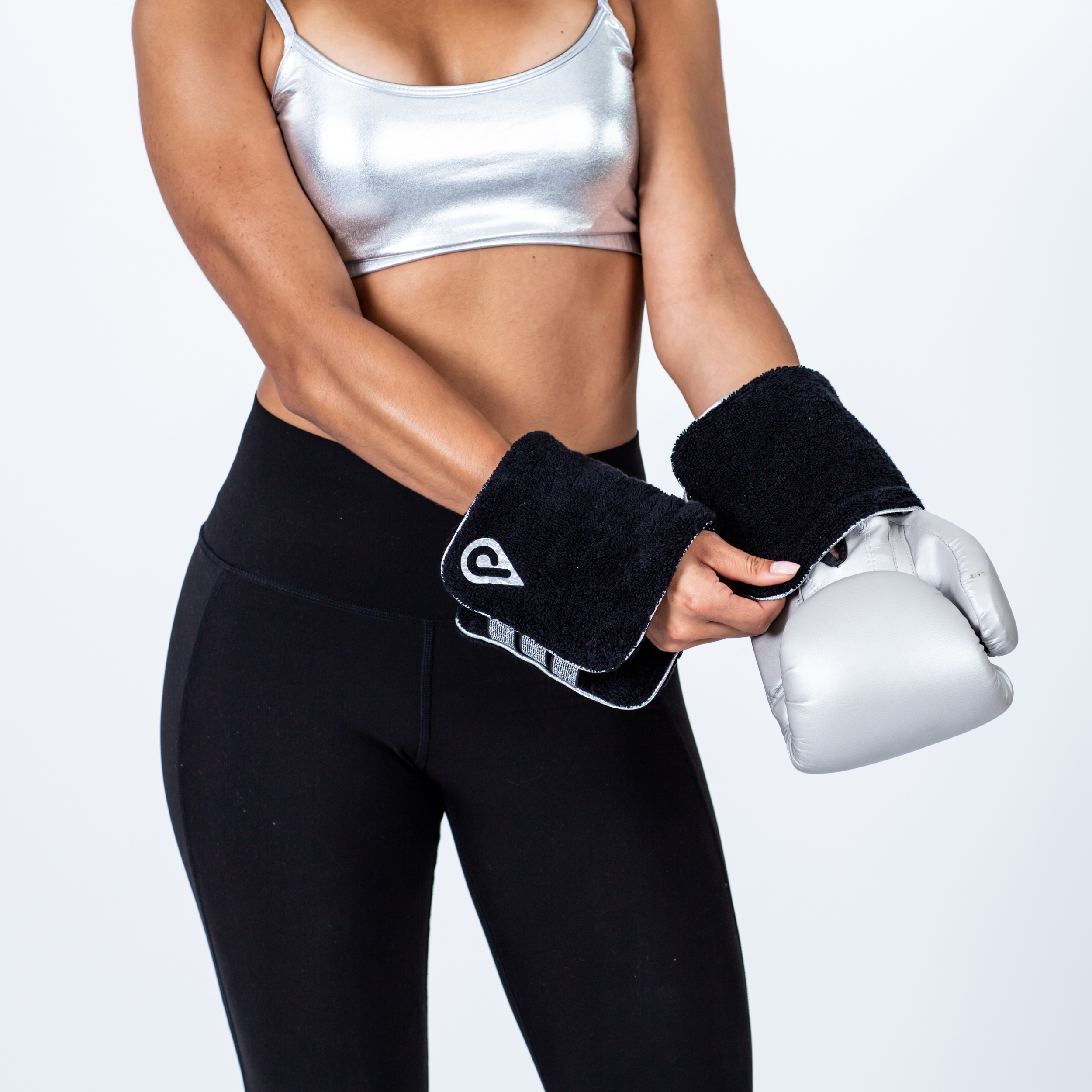 From a commercial photoshoot campaign for fitness accessories. The model is putting on a boxing glove accessory he company's logo.